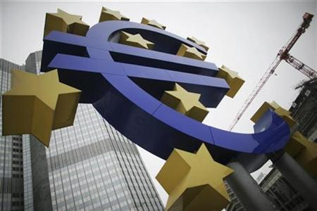 A sculpture showing the Euro currency sign is seen in front of the European Central Bank (ECB) headquarters in Frankfurt, December 5, 2010. REUTERS/Alex Domanski