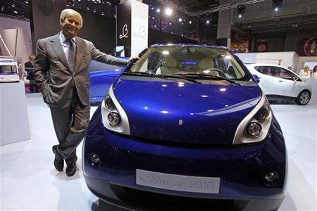 Vincent Bollore Poses Next To A Blue Car Electric On Media Day At The Paris Mondial De L Automobile September 30 2010