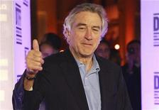 """<p>Actor Robert De Niro gives a thumbs-up as he arrives at the """"Stone"""" film premiere during the 2010 Doha Tribeca Film Festival in Doha October 28, 2010. REUTERS/Mohammed Dabbous</p>"""