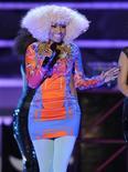 <p>Imagen de archivo de la cantante Nicki Minaj, cuyo éxito fue pronosticado por MTV el 2010, durante una actuación en San Diego. dic 3 2010. ¿El rock está muerto? Larga vida al rock. The Who lo cantó en 1974, pero podría estar hablando del 2011, al menos según MTV . Grupos que incluyen la banda estadounidense de pop punk A Day To Remember, los roqueros daneses New Politics y los británicos de onda retro The Vaccines tuvieron una fuerte presencia en la lista de nueve bandas, que el año pasado predijo el éxito de los raperos Nicki Minaj y B.o.B. REUTERS/K.C. Alfred/Archivo</p>