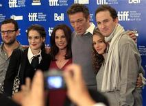 """<p>The cast of """"Black Swan"""" (from L), screenwriter Mark Heyman, actors Winona Ryder, Barbara Hershey, Vincent Cassel, Natalie Portman and director Darren Aronofsky pose for photos during their news conference at the 35th Toronto International Film Festival September 14, 2010. REUTERS/Mike Cassese</p>"""