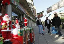 <p>Santa Claus toys are displayed for sale during Christmas eve along a street in Baghdad December 24, 2010. In its latest threat, the Islamic State of Iraq, the local affiliate of al Qaeda, said this week that Iraqi Christians risked further attacks unless they pressured the Christian church in Egypt to release a group of people it said the church was holding after they had converted to Islam. Fearing further bloodshed, several church leaders in Iraq have urged Christians to keep Christmas low-key and limit celebrations to prayers and mass. REUTERS/Mohammed Ameen</p>