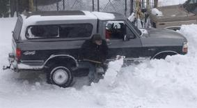 <p>A truck stuck in a snow bank is shoveled out as blizzard-like conditions due to high winds continue in Hoboken, New Jersey, December 27, 2010. REUTERS/Gary Hershorn</p>
