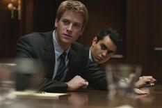 "<p>Actors Armie Hammer (L) and Max Minghella are shown in a scene from the film ""The Social Network,"" in this undated publicity photograph. 24 year-old Armie Hammer, the great grandson of oil tycoon and philanthropist Armand Hammer, portrays both Cameron Winklevoss and Tyler Howard Winklevoss in the film. REUTERS/Merrick Morton/ 2009 Columbia TriStar Marketing Group, Inc. /Handout</p>"