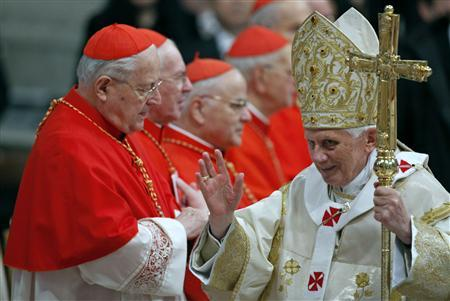 Pope Benedict XVI waves as he leaves after his first mass of the New Year in Saint Peter's Basilica at the Vatican January 1, 2011. REUTERS/Alessia Pierdomenico