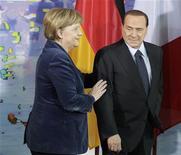<p>Канцолер Германии Ангела Меркель и премьер-министр Италии Сильвио Берлускони после переговоров в Берлине 12 января 2011 года. Премьер-министр Италии Сильвио Берлускони сказал канцлеру Германии Ангеле Меркель, что он больше не против возобновления санкций Евросоюза против Белоруссии, сообщил Рейтер источник, знакомый с ситуацией. REUTERS/Tobias Schwarz</p>