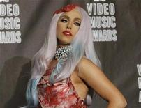 <p>Lady Gaga, wearing an outfit made of meat, poses in the photo room after winning eight awards at the 2010 MTV Video Music Awards in Los Angeles, California September 12, 2010. REUTERS/Mario Anzuoni</p>