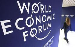 <p>An attendee walks past logos of the World Economic Forum (WEF), at the congress centre of the Alpine resort of Davos, the venue of the Forum, January 31, 2010. REUTERS/Arnd Wiegmann</p>