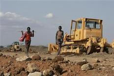<p>Turkana boys walk past a road construction project near Isiolo town, about 320 km (200 miles) north of Kenyan capital Nairobi, July 7, 2008. REUTERS/Antony Njuguna</p>