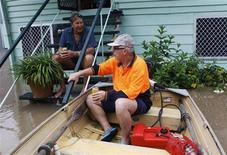 <p>Wayne Carolan (R) shares a beer with his friend Grant Wooler at Wooler's house, which is partially covered by floodwaters in Depot Hill in Rockhampton, Queensland January 5, 2011. REUTERS/Daniel Munoz</p>