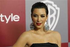 <p>Television personality Kim Kardashian poses at the Warner Bros. and InStyle after party following the 68th annual Golden Globe Awards in Beverly Hills, California January 16, 2011. REUTERS/Mario Anzuoni</p>