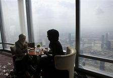 "<p>Women sit at a table in the lounge section during the opening of ""At.Mosphere"" the world's highest restaurant in the Burj Khalifa in Dubai January 23, 2011. REUTERS/Jumana El-Heloueh</p>"