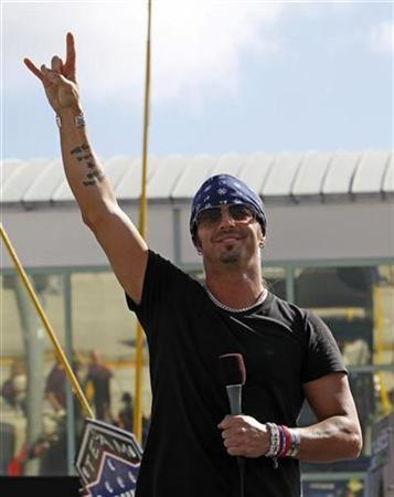 Bret Michaels, rock and roll singer and Celebrity Apprentice TV show personality, reacts after singing the national anthem before the start of the Ford 400 NASCAR Sprint Cup Series race in Homestead, Florida November 21, 2010. REUTERS/Joe Skipper