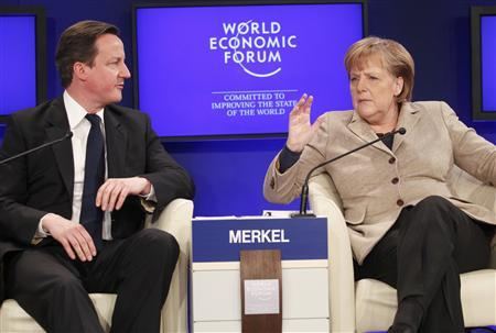 German Chancellor Angela Merkel (R) and Britain's Prime Minister David Cameron attend a session at the World Economic Forum (WEF) in Davos, January 28, 2011. REUTERS/Christian Hartmann
