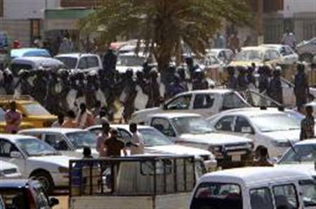 Heavily armed police patrol Khartoum's main streets January 30, 2011. REUTERS/Stringer