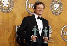 """<p>Actor Colin Firth poses with his two SAG Awards for """"The King's Speech"""" at the 17th annual Screen Actors Guild Awards in Los Angeles, California January 30, 2011. REUTERS/Lucy Nicholson</p>"""