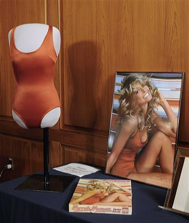 The famous red swimsuit that Farrah Fawcett wore during the photo shoot that resulted in the now iconic original 1976 Farrah Fawcett swimsuit poster is seen in this photograph released by the National Museum of American History in Washington February 2, 2011. Items from actress Farrah Fawcett's career, including that famous red bathing suit, were enshrined in national history on Wednesday via donation to the Smithsonian National Museum of American History. The 1976 iconic image of Fawcett curled up in the one-piece suit and a wide smile sold over 12 million posters and became a recognizable sign of the decade. REUTERS/Courtesy of the Smithsonian's National Museum of American History/Handout