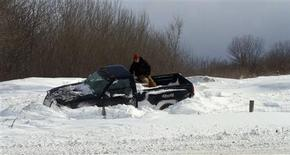 <p>A man sits in the bed of his stranded truck in Milwaukee, Wisconsin February 2, 2011. REUTERS/Darren Hauck</p>