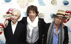 """<p>Rolling Stones band members (L-R) Charles Watts, Mick Jagger, and Keith Richards pose as they arrive for the premiere of the documentary film """"Stones In Exile"""" in New York May 11, 2010. REUTERS/Lucas Jackson</p>"""