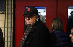 <p>Director Michael Moore walks into a theater during the Sundance Film Festival in Park City, Utah January 20, 2011. REUTERS/Lucas Jackson</p>