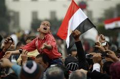 <p>Демонстранты протестуют на площади Тахрир в Каире, 7 февраля 2011 года. Египетские демонстранты призвали своих единомышленников совершить решающий рывок для свержения президента Хосни Мубарака после того, как власти не изъявили готовность идти на серьезные уступки в ходе переговоров с оппозицией. REUTERS/Dylan Martinez</p>