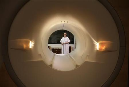 A cancer is seen through the tube of a magnetic resonance imaging scanner in a file photo. REUTERS/Jim Bourg