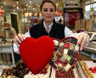 <p>A vendor in a chocolate shop holds up Belgian praline boxes made for Valentine's Day in Brussels February 13, 2007. REUTERS/Yves Herman</p>