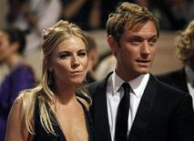 """<p>Sienna Miller (L) and Jude Law arrive at the Metropolitan Museum of Art Costume Institute Benefit celebrating the opening of, """"American Woman: Fashioning a National Identity"""" in New York May 3, 2010. REUTERS/Jessica Rinaldi</p>"""