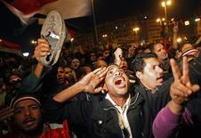 <p>Opposition supporters shout in their stronghold of Tahrir Square, in Cairo February 10, 2011. REUTERS/Suhaib Salem</p>