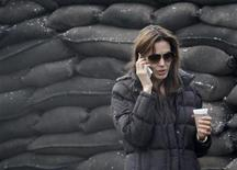 <p>Actress Angelina Jolie uses a mobile phone at the set during the filming of her yet untitled directorial debut in Esztergom (60 km north of Budapest) November 12, 2010. REUTERS/Laszlo Balogh</p>