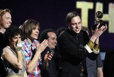 """<p>Edwin Butler of Canadian band Arcade Fire holds up the Grammy for Album of the Year for """"The Suburbs"""" at the 53rd annual Grammy Awards in Los Angeles, California February 13, 2011. REUTERS/Lucy Nicholson</p>"""
