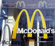 <p>McDonald's logo is seen on the window of one of its restaurants in New York January 24, 2011. REUTERS/Shannon Stapleton</p>