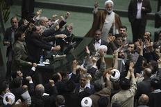 <p>Members of the Iranian parliament shout slogans calling for the execution of opposition leaders before the start of their session in Tehran February 15, 2011. REUTERS/Raouf Mohseni/Mehr News/Handout</p>
