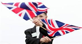<p>An eight-year-old boy from Oxford, England waves British flags ahead of a ceremony at Pegasus Bridge in Benouville, France June 5, 2004. REUTERS/Yves Herman</p>