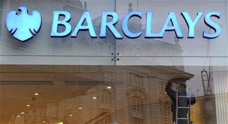 A worker carries out maintenance in a branch of Barclays bank in central London February 15, 2011. REUTERS/Paul Hackett
