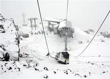 <p>The damaged cabin of a cable car, which was blown up on Friday night by attackers, is seen near Mount Elbrus in Kabardino-Balkaria in Russia's North Caucasus region February 20, 2011. REUTERS/Yevgeny Kayudin</p>
