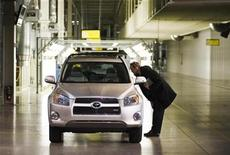 <p>A man looks at a new Toyota RAV4 at a Toyota automobile assembly plant in a file photo. REUTERS/Mark Blinch</p>