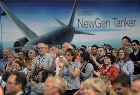 Boeing Commercial Airplanes division employees cheer during a rally supporting the company's bid to use the 767 jet for a new U.S. Air Force tanker fleet at Boeing's manufacturing facilities in Everett, Washington, September 27, 2010. REUTERS/Anthony Bolante