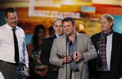 """<p>Producers of the film """"Black Swan"""" (L-R) Brian Oliver, Arnold Messer, Scott Franklin and Mike Medavoy, accept the award for best feature at the 2011 Film Independent Spirit Awards in Santa Monica, California February 26, 2011. REUTERS/Rick Wilking</p>"""