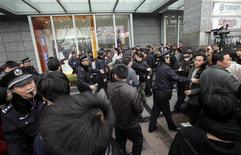 "<p>Police disperse a crowd after calls for a ""Jasmine Revolution"" protest, organised through the internet, in front of the Peace Cinema in downtown Shanghai February 27, 2011. An online call for anti-government protests across China on Sunday instead brought an emphatic show of force by police determined to deter any buds of the kind of unrest that has shaken the Middle East. Lines of police checked passers-by and warned away foreign photo journalists in downtown Beijing and Shanghai after a U.S.-based Chinese website spread calls for Chinese people to emulate the ""Jasmine Revolution"" sweeping the Middle East and stage gatherings in support of democratic change. REUTERS/Carlos Barria</p>"