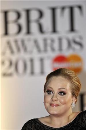 British singer Adele Adkins arrives to attend the BRIT music awards at the O2 Arena in London February 15, 2011. REUTERS/Toby Melville