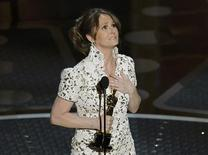 """<p>Melissa Leo accepts the Oscar for best supporting actress for her role in """"The Fighter"""" during the 83rd Academy Awards in Hollywood, California, February 27, 2011. REUTERS/Gary Hershorn</p>"""