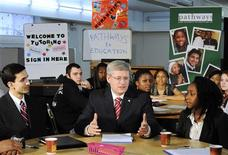 "<p>Prime Minister Stephen Harper talks to students while pledging support for the ""Pathways to Education Canada"" in Toronto, March 3, 2011. REUTERS/Mark Blinch</p>"