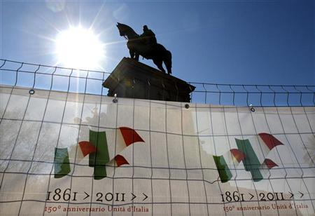 The monument to Giuseppe Garibaldi, the hero of Italian unification, undergoes restoration surrounded by posters proclaiming the 150th anniversary of Italian unity, at the Gianicolo hill in Rome March 8, 2011. REUTERS/Max Rossi (ITALY - Tags: POLITICS)