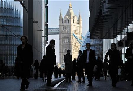 Office workers are seen in the London Place business district near Tower Bridge in central London February 9, 2011. REUTERS/Toby Melville