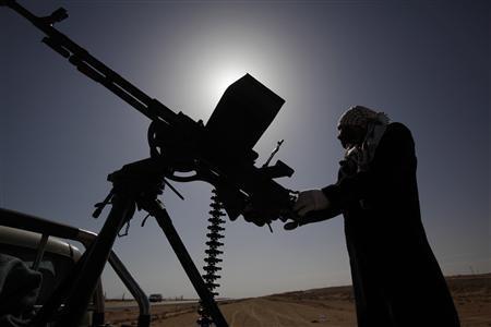 Anti-Gaddafi rebels prepare their anti-tank guns in case of air strikes as pro-Gaddafi forces took over the city of Ras Lanuf March 11, 2011. REUTERS/Asmaa Waguih