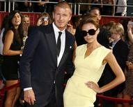 <p>Soccer star David Beckham and his wife Victoria arrive at the 2008 ESPY Awards in Los Angeles, California July 16, 2008. REUTERS/Danny Moloshok</p>