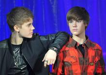 <p>Canadian singer Justin Bieber (black top) poses with a waxwork model of himself during an official unveiling at Madame Tussauds wax museum in central London March 15, 2011. REUTERS/Toby Melville</p>