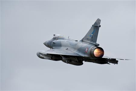 A French Mirage 2000-5 aircraft, seen in this photo released by ECPAD (French Defence communication and audiovisual production agency), takes off from the Dijon military base on a mission to overfly Libya March 19, 2011. REUTERS/ECPAD/SIRPA AIR/Anthony Jeuland