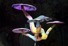 <p>A member of the Imperial Circus of China performs in Montevideo July 4, 2007. REUTERS/Andres Stapff</p>